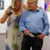 Sabine Schäfer-Gold und Roland Haas rufen die Gäste auf, das Portrait-Puzzle zu lösen